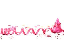 桃红色丝带狂欢节题材与帽子的 免版税库存图片