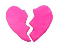 桃红色伤心形状彩色塑泥黏土 库存图片