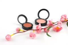 桃红色和桔子脸红用假桃红色花装饰 库存照片