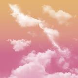桃红色和橙色口气和白色多云 库存图片