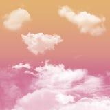 桃红色和橙色口气和白色多云 免版税库存图片