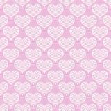 桃红色和白色雪佛心脏样式重复背景 免版税库存照片