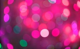桃红色和红色假日bokeh 抽象背景圣诞节 免版税库存图片