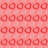 桃红色和红色心脏无缝的华伦泰背景 免版税库存照片