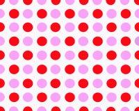 桃红色和红色被加点的背景 库存照片