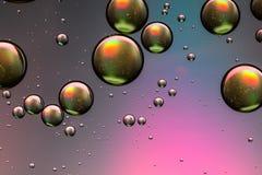 桃红色和金油和水抽象背景 库存图片