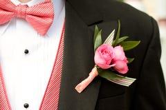 桃红色和黑无尾礼服 库存照片