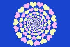 桃红色和黄色心脏圈子在明亮的蓝色的 免版税图库摄影