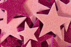 桃红色和紫色闪烁星背景 免版税库存图片