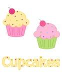 桃红色和黄色结霜的杯形蛋糕 免版税图库摄影