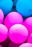 桃红色和bule气球 免版税库存图片