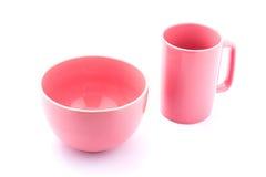 桃红色咖啡杯和桃红色碗 免版税图库摄影