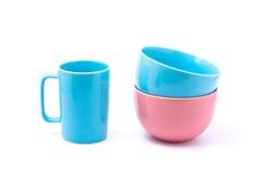 桃红色咖啡杯和浅兰的碗和桃红色碗 免版税图库摄影
