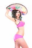 桃红色女用贴身内衣裤的俏丽的妇女 免版税库存照片