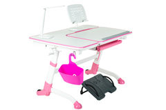 桃红色学校书桌、桃红色篮子、台灯和黑支持在腿下 免版税库存照片