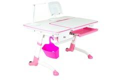 桃红色学校书桌、桃红色篮子和台灯 库存照片