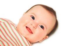 桃红色帽子的女婴 免版税库存图片