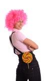 桃红色微笑的青少年的假发 免版税库存图片