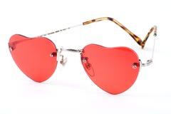 桃红色心形的太阳镜 库存图片