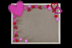 桃红色心脏和pom poms边界在一个简单的留言簿,空间 库存图片