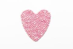 桃红色心脏在白色背景洒 免版税图库摄影