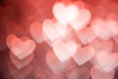 桃红色心脏形状假日背景 免版税图库摄影