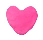 桃红色心脏形状彩色塑泥黏土 库存照片
