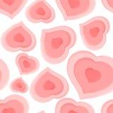从桃红色心脏的无缝的样式 免版税库存照片