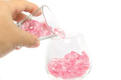 桃红色心脏玻璃在白色背景 库存照片
