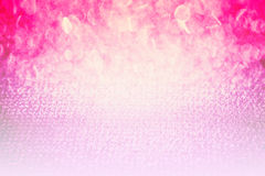 桃红色抽象发光的闪烁bokeh背景,容易的作为当代背景的用途秀丽俏丽的空间设计 库存照片