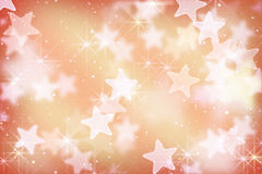 桃红色星形和bokeh光 免版税库存照片