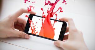 桃红色油漆的综合图象飞溅并且下降 库存图片