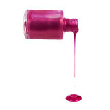 桃红色淡紫色指甲油流,查出 免版税库存照片