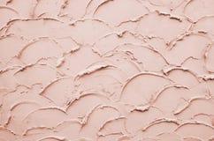 桃红色灰泥表面墙壁 免版税库存照片