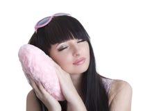 桃红色玻璃的美丽的休眠的妇女 免版税库存图片