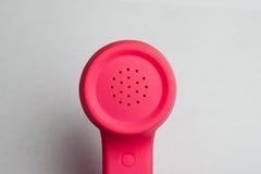 桃红色电话报告人 库存图片