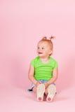 桃红色的小孩女孩 免版税库存图片