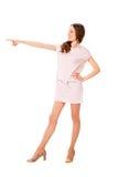 桃红色礼服摆在的年轻亭亭玉立的俏丽的妇女 库存照片