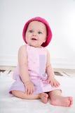 桃红色礼服的女婴 免版税图库摄影