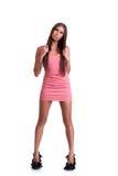 桃红色礼服的少妇 免版税库存照片