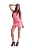 桃红色礼服的少妇 库存照片