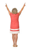 桃红色礼服的成熟妇女 免版税库存照片