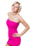 桃红色礼服的美丽的妇女 免版税库存图片