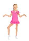桃红色礼服的美丽的芭蕾舞女演员 免版税图库摄影