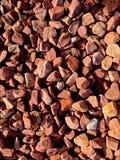 桃红色红色小卵石和岩石纹理  库存图片