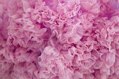 桃红色纺织品翻动背景 图库摄影
