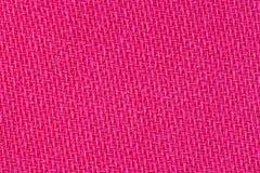 桃红色织品背景纹理 纺织材料特写镜头细节  图库摄影