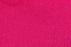 桃红色织品背景纹理 纺织材料特写镜头细节  免版税库存照片