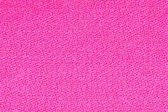 桃红色织品背景纹理 纺织材料特写镜头细节  免版税库存图片