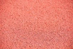 桃红色背景,沥青路面。 免版税库存图片